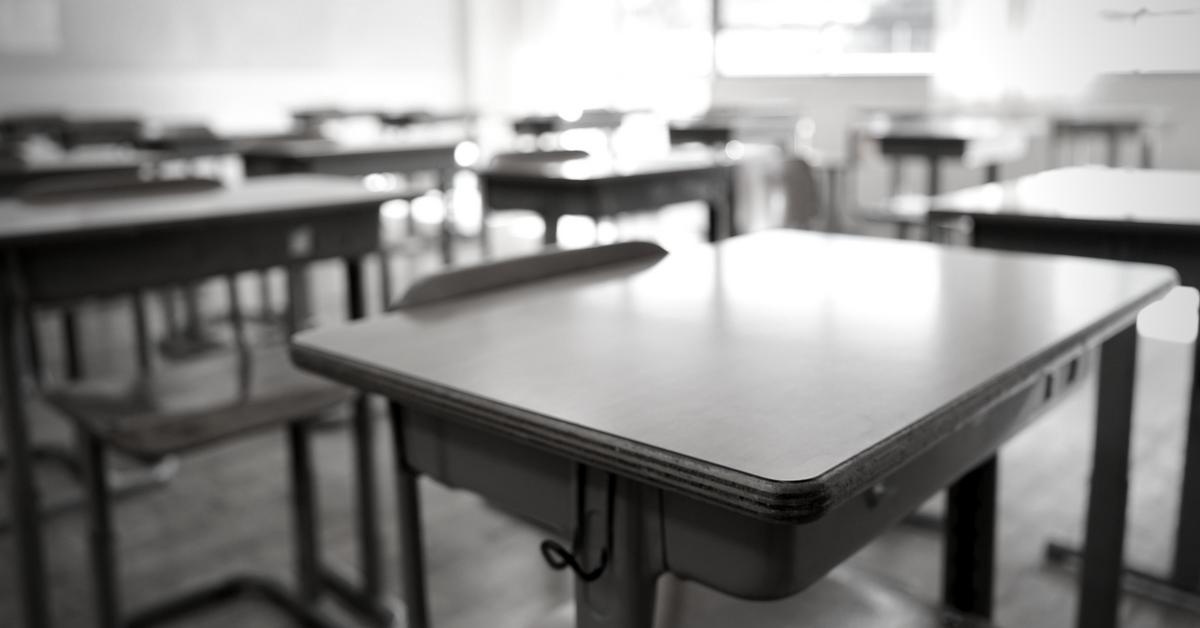 Empty classroom and school desks