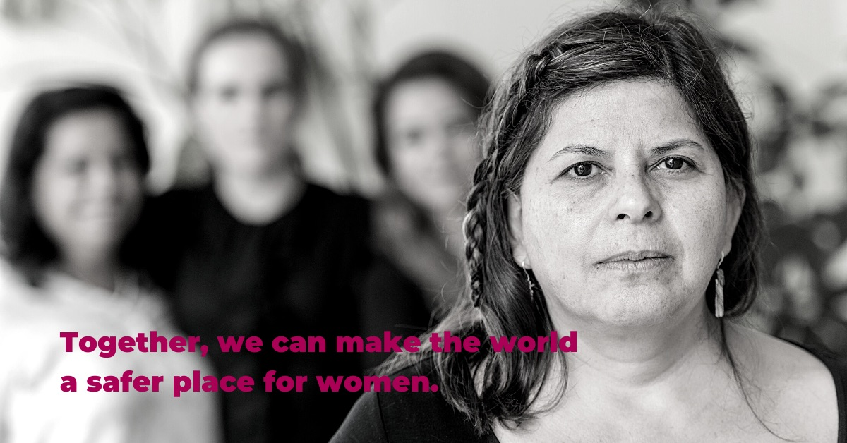 Black and white close-up photo of a woman with three other women in the background. Text: Together, we can make the world a safer place for women.