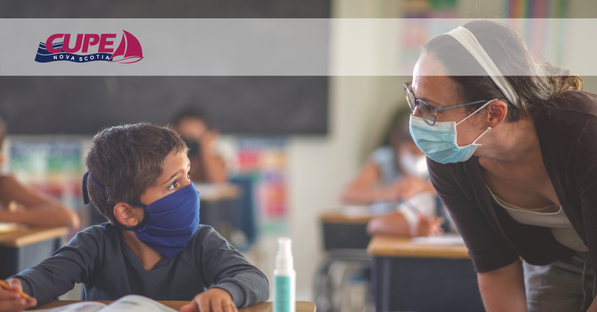 Web banner. Image Teacher talking to young student at his desk. Both are wearing face masks. CUPE NS logo.