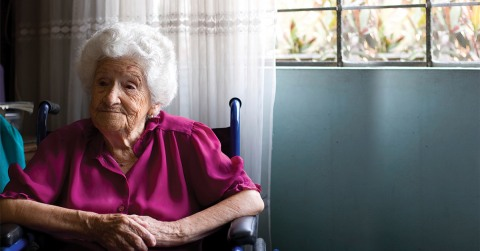 Elderly woman in a wheelchair in a long-term care home