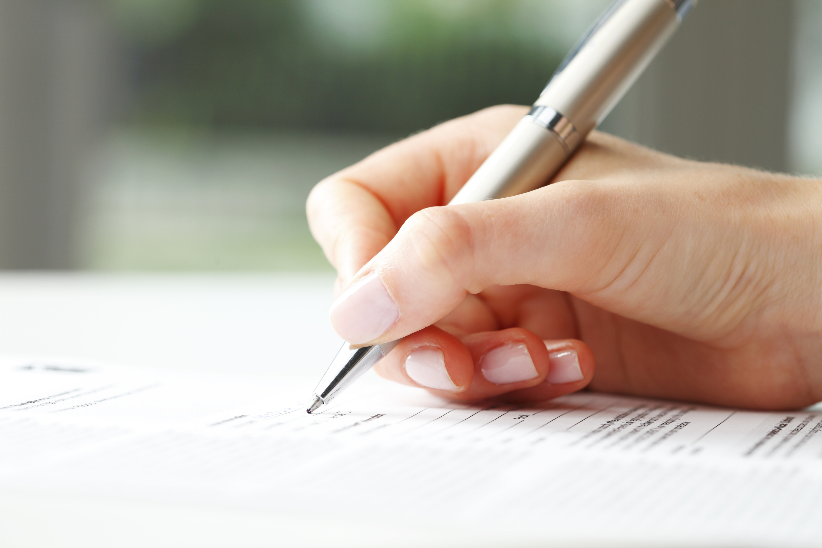 Woman writing on a form